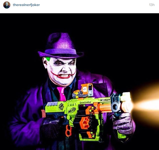 the nerf joker with the nerf zombie strike doominator blaster